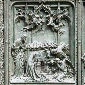 Nativity scene on bronze doors of Milan Duomo