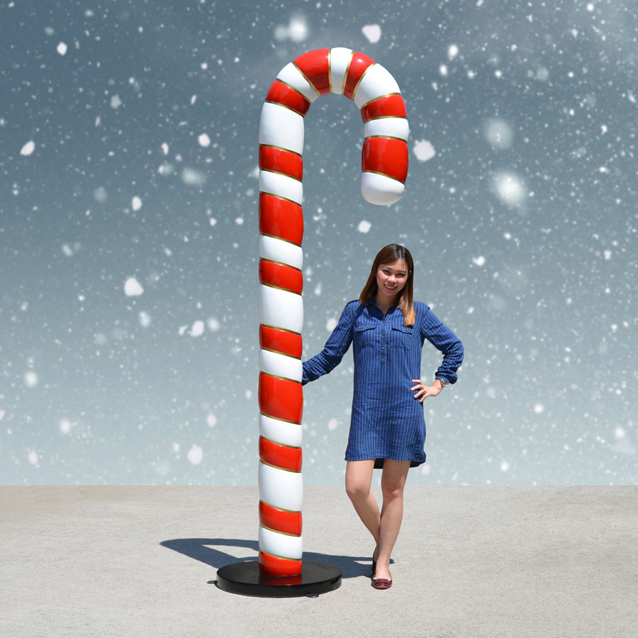 Girl with giant candy cane