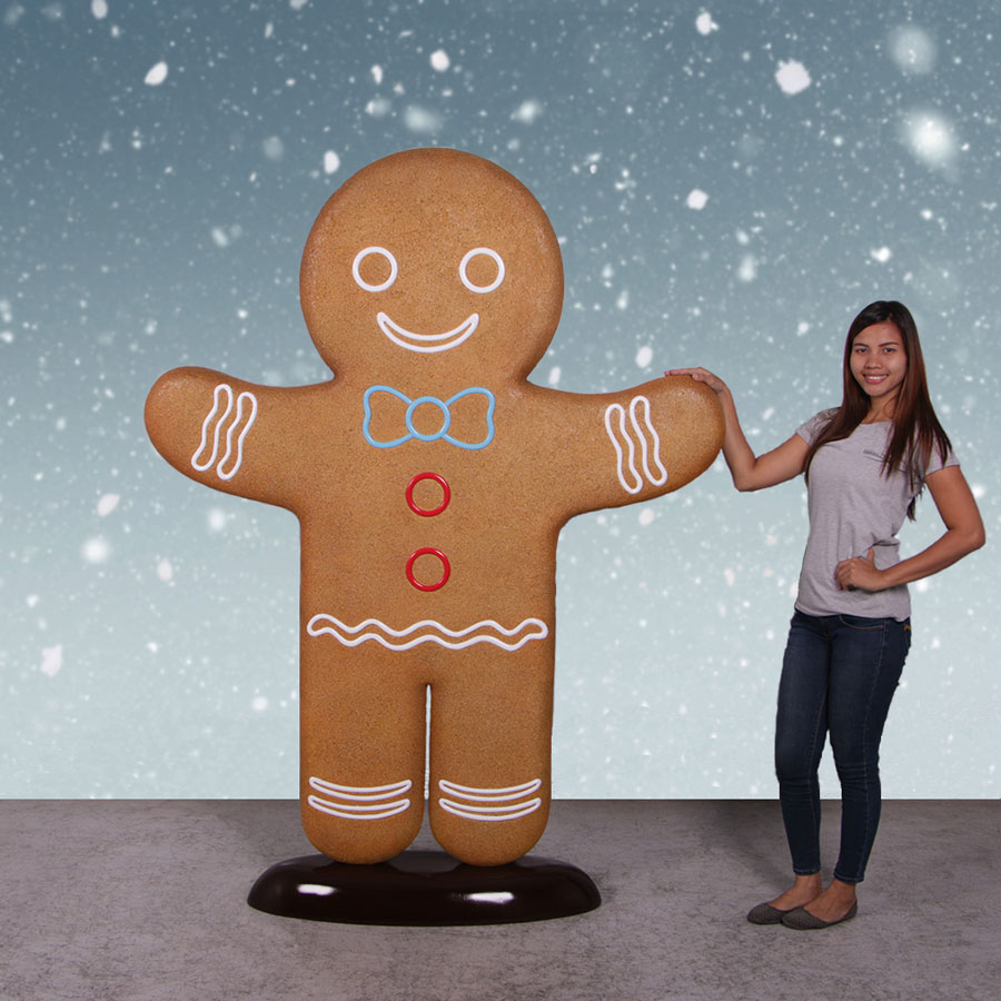 Girl with giant gingerbread man