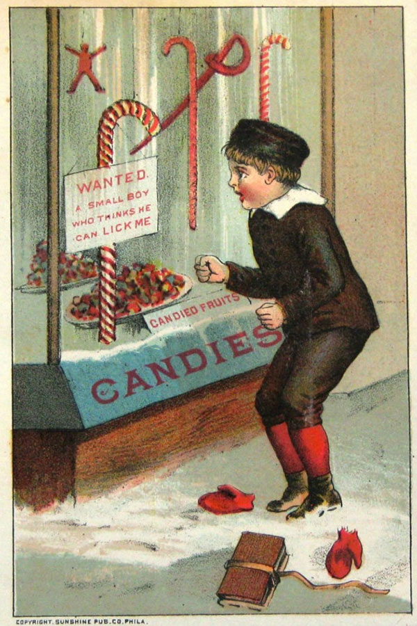 Boy looking at a candy cane in a store window