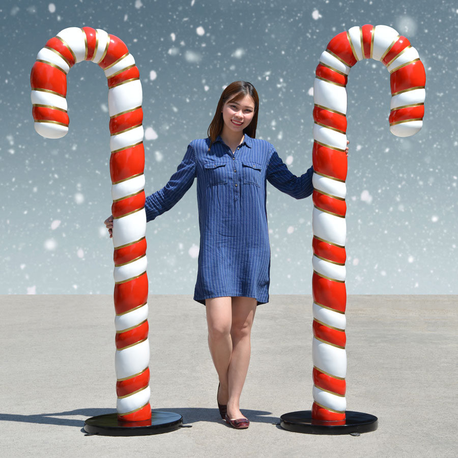 Woman with two giant candy canes